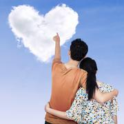 Young couple pointing at heart Stock Illustration