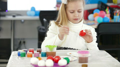 Cute girl painting easter eggs Stock Footage