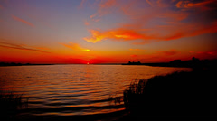Sunset on the river. 4K. FULL HD, 4096x2304. Stock Footage