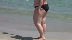 Fat young woman on the beach, cellulite, obesity, overweight woman Stock Footage