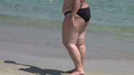 Stock Video Footage of Fat young woman on the beach, cellulite, obesity, overweight woman