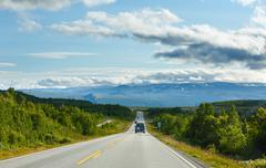 norwegian summer road (near dombas, norge) - stock photo