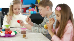 Kids painting easter eggs Stock Footage