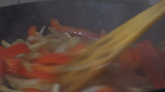 Chicken Stroganoff Mixing The Onion And The Bell Pepper Close Up-Shot Stock Footage