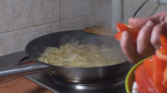 Chicken Stroganoff Adding Bell Pepper Into The Frying Pan Stock Footage
