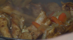 Chicken Stroganoff Mixing The Chicken Into The Frying Pan Close Up-Shot Stock Footage