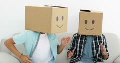 Silly employees with boxes on their heads doing the robot - stock footage