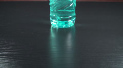 Bottle Of Water Tilt-Shot Stock Footage