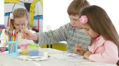 Children painting at kindergarten Stock Footage