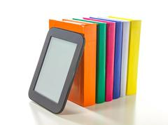 Electronic book reader with hard cover books Stock Photos