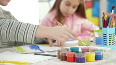 Children painting in watercolor Stock Footage