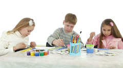 Children painting in art class - stock footage