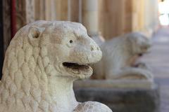romanesque lion statue in Modena, Italy - stock photo