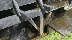 Overshot water wheel, vertically mounted water wheel rotated by falling water Stock Footage