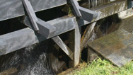 Stock Video Footage of Overshot water wheel, vertically mounted water wheel rotated by falling water