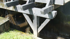 Overshot water wheel in operation - side view Stock Footage
