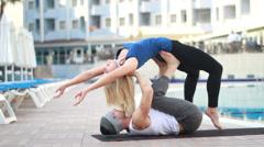 Couple near the pool, couple yoga& Stock Footage