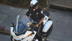 Highway patrol police officer checking the speed by radar in Los Angeles Stock Footage