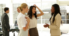 Businesswomen talking together Stock Footage