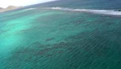 Antigua helicopter 120, see from above how the waves are breaking over corals - stock footage