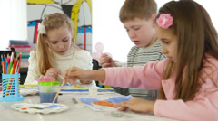Children painting in playroom Stock Footage