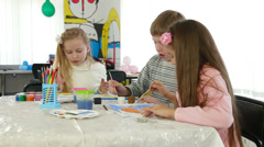 Children painting and playing at kindergarten Stock Footage