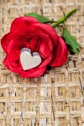 Fake rose wooden heart Stock Photos