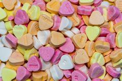 Full frame candy hearts Stock Photos