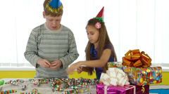 Children preparing for a birthday party Stock Footage