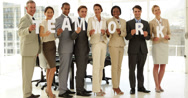 Stock Video Footage of Happy business people holding letters spelling teamwork