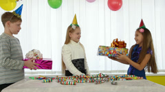 Children give gifts at birthday party Stock Footage