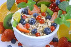 oatmeal with berries and fruits - stock photo
