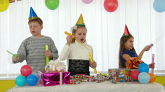 Children blowing bubbles at birthday party - stock footage