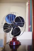 Old fan at workspace of a loft - stock photo