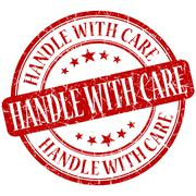 Handle with care grunge red round stamp Stock Illustration