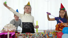 Children with soap bubbles at birthday party - stock footage