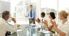 Business people applauding their colleague after presentation - stock footage