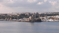 Greece, Rhodes, approaching the coast of Rhodes, Rhodes Old Town from the sea Stock Footage
