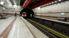 Clean shinny metro entering the station Stock Footage