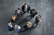 Stock Photo of Germany, Neuss, Business people standing on floor, looking up