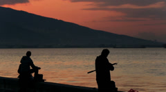 Silhouette fisherman throws fishing tackles at morning Stock Footage