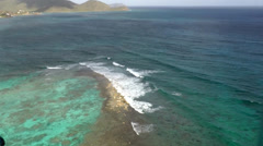 Antigua helicopter 121, flight over a coral reef and beautiful hills and bays Stock Footage