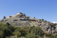 Turkey, Lycia, Ancient city Tlos, Acropolis with fortress and Lycian rock tombs Stock Photos