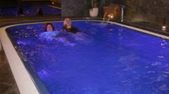 Women enjoying wellness and Spa swimming pool - stock footage