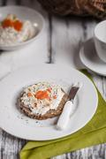 German dark multi-grain bread with cream cheese and carrots, cup of coffee Stock Photos