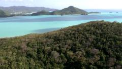 Antigua helicopter 119, flight over turquoise sea and green hills, jolly beach Stock Footage