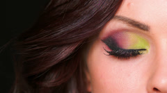 Beautiful Woman Making Faces, She Has Colorful Eye Makeup Stock Footage
