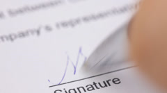 Stock Video Footage of Hand signing a contract.