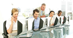 Manager checking on call centre agents - stock footage