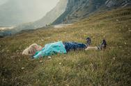 Stock Photo of Italy, Province of Belluno, Veneto, Auronzo di Cadore, little boy lying on